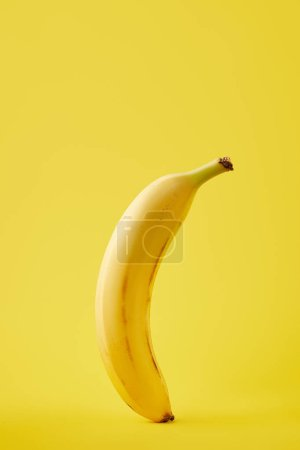 Photo for Close up view of fresh banana isolated on yellow - Royalty Free Image