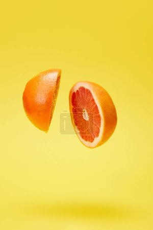 Photo for Close up view of cut grapefruit isolated on yellow - Royalty Free Image