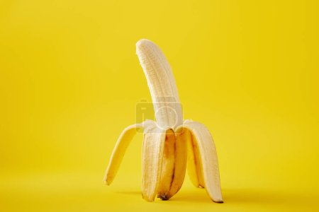 Photo for Close up view of ripe banana isolated on yellow - Royalty Free Image