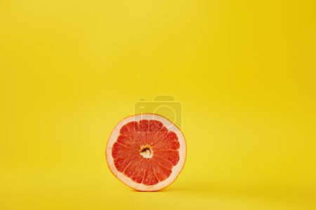 Photo for Close up view of fresh ripe grapefruit isolated on yellow - Royalty Free Image