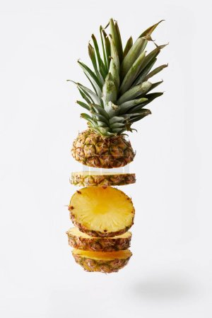 close up view of fresh cut pineapple exotic fruit isolated on white