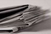close up of pile of newspapers, selective focus on white