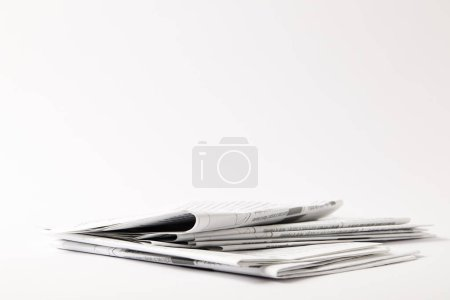 pile of business newspapers, isolated on white with copy space