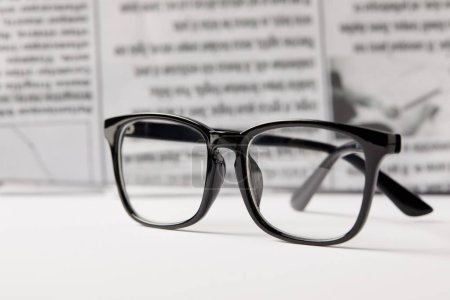 Photo for Selective focus of eyeglasses and newspaper on background - Royalty Free Image
