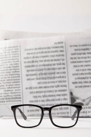 Photo for Selective focus of black eyewear and newspaper on background, black and white - Royalty Free Image