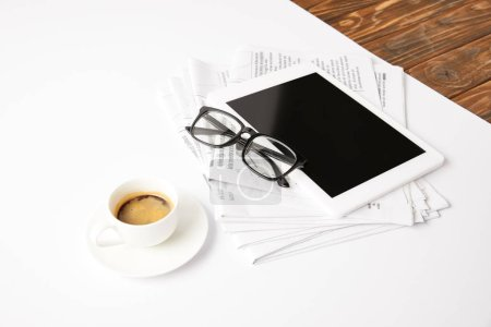 eyesight, cup of coffee, newsprint and digital tablet with blank screen, on white