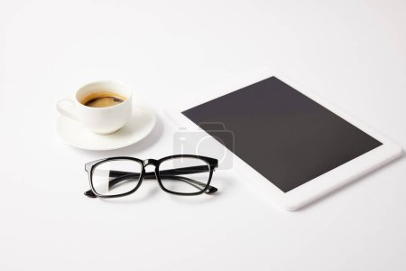 cup of coffee, glasses and digital tablet with blank screen on white table