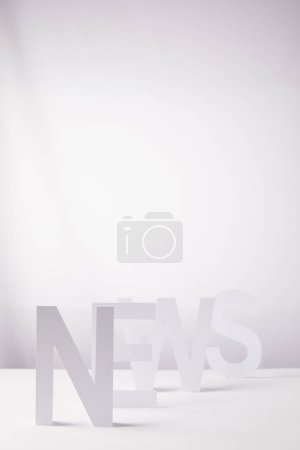 white word news made of paper letters, on white background with copy space