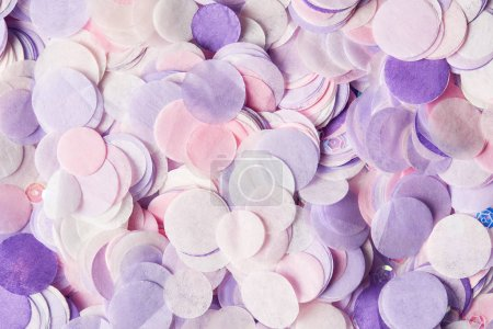 close up of violet confetti pieces on surface