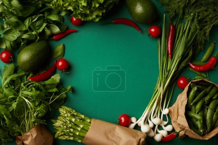 Photo for Top view of round frame made of various ripe vegetables on green surface - Royalty Free Image