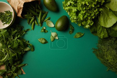 Photo for Top view of different ripe vegetables on green surface - Royalty Free Image