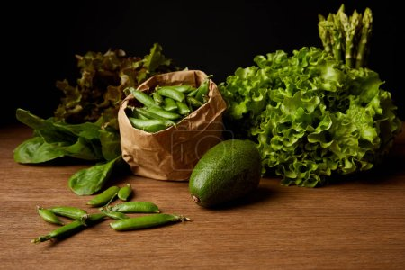 close-up shot of fresh green vegetables on wooden surface