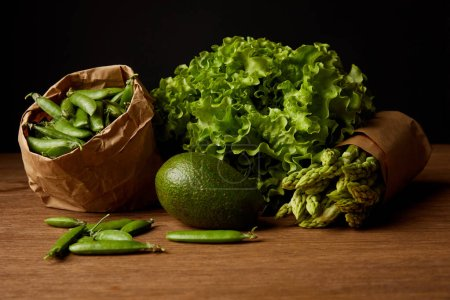 Photo for Close-up shot of healthy green vegetables on wooden surface - Royalty Free Image