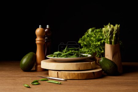 row green vegetables on wooden surface