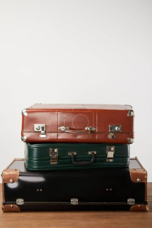 Vintage leather suitcases on wooden table