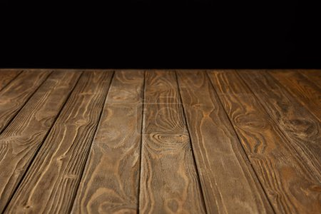 Photo for Empty wooden tabletop isolated on black - Royalty Free Image