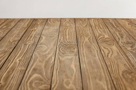 Photo for Empty wooden tabletop isolated on grey - Royalty Free Image