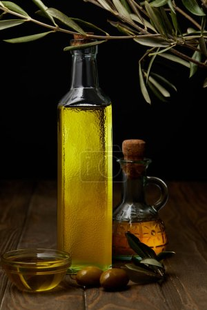 bottles of olive oil on wooden tabletop