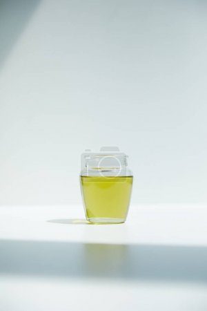 closeup shot of aromatic olive oil jar on white background