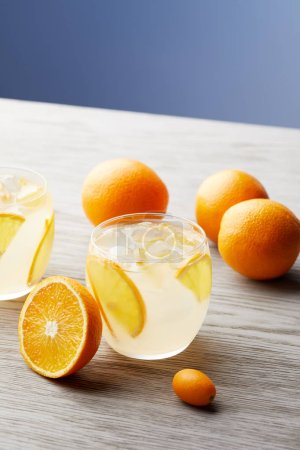 close-up shot of glasses of orange lemonade on wooden surface