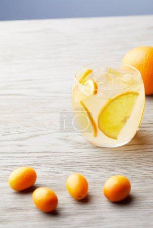 close-up shot of orange lemonade on wooden surface
