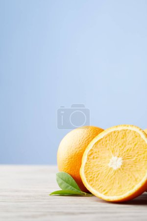 close-up shot of ripe oranges on wooden surface