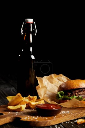 Set of junk food diner with hamburger and potato served with beer