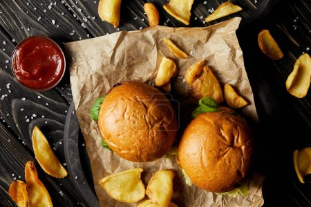 Photo for Top view of tempting fast food diner with burgers and potatoes - Royalty Free Image