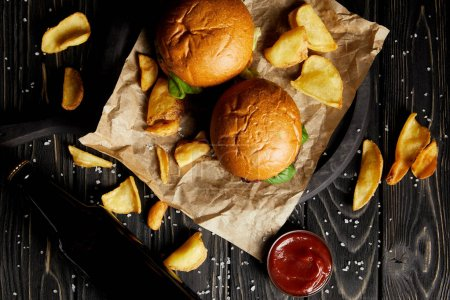 Set of junk food hamburgers and fried potatoes on craft paper