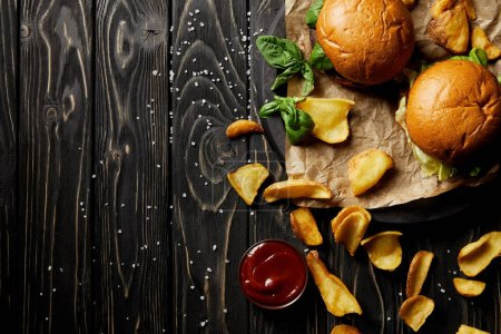 Top view composition of set of junk food diner with burgers and potato on table