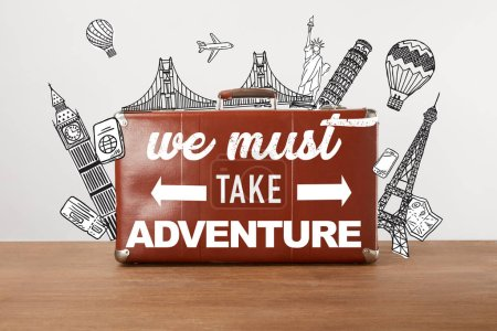 Vintage brown leather travel bag with illustration and inspiration - we must take adventure