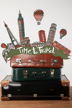 Stacked old leather suitcases with Time to travel inspiration and cities illustration