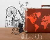 Brown vintage suitcase with map and travel illustrations