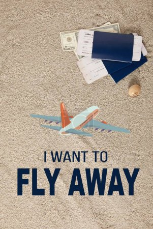 "Photo for Top view of arranged passports, tickets and dollar banknotes on sand with ""I want to fly away"" lettering and airplane illustration - Royalty Free Image"
