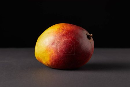fresh raw of mango on black background