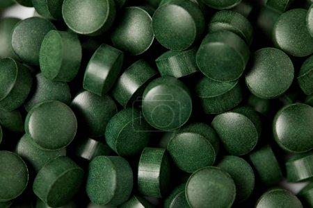 full frame image of pile of spirulina pills background