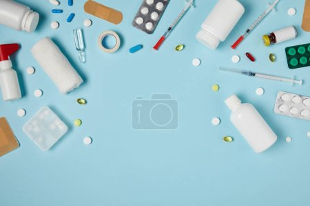 top view of frame made of various medicines on blue surface