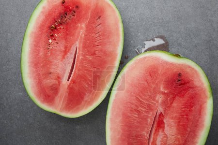 top view of ripe watermelon pieces on grey concrete tabletop