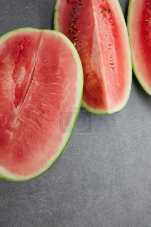 Photo for Flat lay with arranged watermelon pieces on grey concrete tabletop - Royalty Free Image