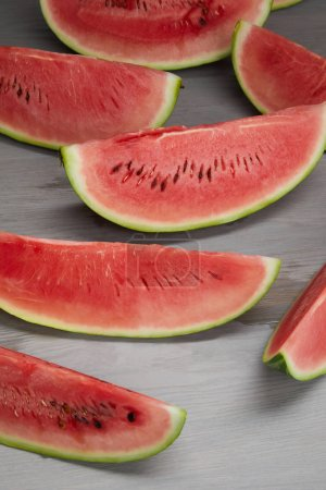 food composition with fresh watermelon slices on grey wooden surface