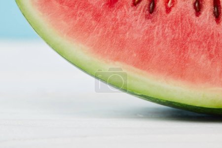 close up view of fresh watermelon slice on white surface