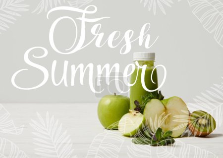 green detox smoothie with apples, kiwi and mint and on white wooden surface, fresh summer inscription