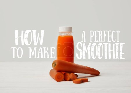 bottle of detox smoothie with carrots on white wooden surface, how to make perfect smoothie inscription