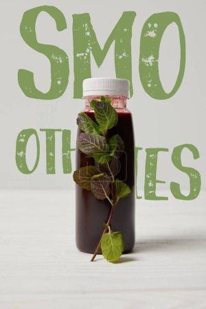 bottle of detox smoothie with mint on white wooden surface, smoothies inscription