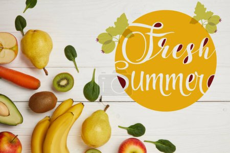 top view of fresh fruits and spinach leaves on white wooden background with copy space, fresh summer inscription