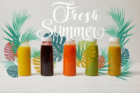 detox smoothies in bottles standing in row, refresh concept, fresh summer inscription