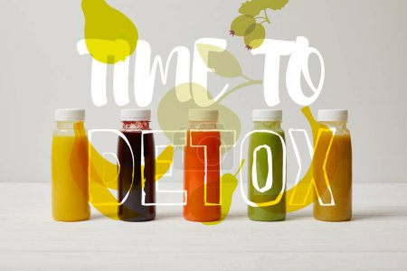 detox smoothies in bottles standing in row, refresh concept, time to detox inscription