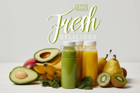 fresh detox fruits and smoothies on white background, green fresh delicious inscription