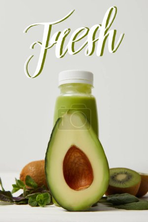 Photo for Green detox smoothie with avocado, kiwi and mint on white wooden surface, fresh inscription - Royalty Free Image
