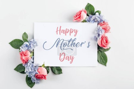 floral composition with roses, hydrangea flowers and blank card, isolated on white, happy mothers day inscription